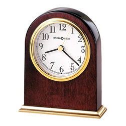 """Howard Miller - Metal Base Table Clock with Waterfall Bezel - This clock seems to make time stand still with its gorgeous mahogany shine. Bold golden finishes encircle the handsome face of this timepiece and the standing base. Add a sense of sophistication to your home d̩cor with this wonderful piece. * This table clock is arch shaped and offers a brass finished metal base. . The white dial features a polished brass finished waterfall bezel, black numerals and hands with a brass second hand. . Finished in Rosewood Hall on select hardwoods and veneers. . Quartz movement includes battery. . H. 5-1/4"""" (13 cm). W. 4-1/4"""" (11 cm). D. 1-1/2"""" (4 cm)"""