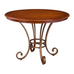 Home Styles St. Ives Round Dining Table - The Home Styles St. Ives Round Dining Table will add a touch of warmth to your home and is the perfect size for an apartment or breakfast nook. The cherry finish and antiqued brass base work with any decor. This table is sure to snazz up even the drabbest room. Adjustable nylon gliders ensure your floor is protected and keep the table base stable on uneven surfaces. About Home StylesHome Styles is a manufacturer and distributor of RTA (ready to assemble) furniture perfectly suited to today's lifestyles. Blending attractive design with modern functionality their furniture collections span many styles from timeless traditional to cutting-edge contemporary. The great difference between Home Styles and many other RTA furniture manufacturers is that Home Styles pieces feature hardwood construction and quality hardware that stand up to years of use. When shopping for convenient durable items for the home look to Home Styles. You'll appreciate the value.