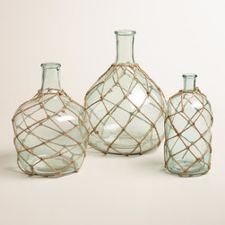 Glass Bottle With Jute Trim - These sea glass–inspired jugs have a very coastal style, especially with the jute rope detail. Arrange all three in your home for the perfect accent.