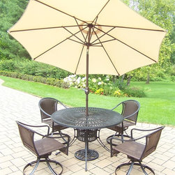 Oakland Living - 7-Pc Outdoor Traditional Dining Table Set - Includes one dining table and four swivel resin wicker chairs, 9 ft. tilt and crank umbrella and stand. Umbrella hole. Metal hardware. Fade, chip and crack resistant. Warranty: One year limited. Made from aluminum, steel and resin wicker. Black hardened powder coat finish. Minimal assembly required. Table: 48 in. Dia. x 29 in. H. Swivel chair: 25.5 in. W x 23.25 in. D x 34 in. H (24 lbs.). Overall weight: 194 lbs.This dining set is the perfect piece for any outdoor dinner setting. Just the right size for any backyard or patio. The Oakland Sunray Collection combines contemporary style and modern designs giving you a rich addition to any outdoor setting. The traditional lattice pattern and scroll work is crisp and stylish. Each piece is hand cast and finished for the highest quality possible.
