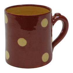 Polka-Dot Mug, Red, 3.25w X 3.5h - This festive cup, by Richard Esteban, hits the spot. Use it to serve warm hot cocoa topped with whipped cream or as your morning mug filled with your favorite brew. The interior (and the dots) are glazed in a warm, buttery yellow that complements the warm exterior color.