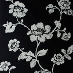 Kenneth James - Lieto Black Floral Trail Wallpaper - Here's a striking trail of blossoms to brighten any room. A bold black background comes to life with flowing flowers in shimmering silver. This is the romantic wallpaper you've been looking for to complete your eclectic chic entryway or bath.