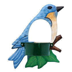 Songbird Essentials - Bluebird Window Birdfeeder - Bring feathered friends closer to you with Songbird Essentials' window birdfeeders. Each feeder is hand-carved from albesia wood, a renewable resource, then hand painted on both sides and coated with polyurethane for added protection. Designed with a hole to watch the visiting bird, one side includes suction cups to firmly attach the feeder to a window. The feeding side has a finished metal cup with a screen bottom to keep seeds dry.