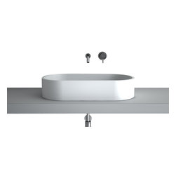 Maestrobath - Teknoform Kappa XL European Bathroom Sink - Designed elegantly in the shape of a rectangle with generously round edges this A.D.A compliant vessel sink is unique in every way. Unlike many other counter top wash basins, The high end bathroom sink seems to be extruding out of its surrounding due to its straight walls and no space underneath which make it sit flush on the counter top. Made out of TeknoForm, a durable polymer-based material, the luxury bathroom sink is available in a clean white color and it may very well be the perfect sink for your contemporary space.