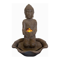"Welland - Welland Tabletop Kneeling Buddha Water Feature with LED Light - The ""Kneeling Buddha"" tabletop fountain is made of a durable and lightweight poly-resin but with a ceramic look finish. Includes a pump and an LED light illuminating the water flow. This fountain brings a calming presence and is ideal for both indoor and outdoor decoration."