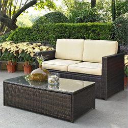 Crosley Palm Harbor 2 Piece Outdoor Wicker Seating Set - Set your ice cold beverage on the table and lounge around on our elegantly designed all-weather wicker loveseat. Finely crafted with intricately woven wicker over durable aluminum frames, this timeless wicker furniture provides lasting comfort and style. Let your worries fade away as you doze off in our UV/fade resistant cushions.