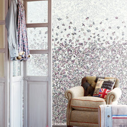 Raval - With a pop of British flavor, this eclectic style living room mixes vintage prints with a whimsical floral backdrop.