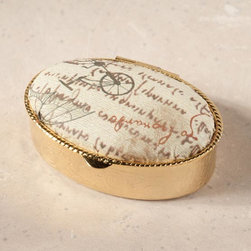"Exposures - Firenze Pill Box - Da Vinci - Overview Pretty pill boxes make lovely accents on top of a vanity or bureau. Our exclusive design features handmade Florentine paper in a pattern reproduced from Leonardo Da Vincis notes. Perfect gift idea for pill box collectors. Made in Italy.  Features Gold tone metal Handmade paper  Paper is a reproduction of Leonardo Da Vincis notes Made in Italy    Specifications  Measures 2 wide x 1 1/2"" long x 3/4"" deep"