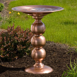 Copper Topiary Pedestal Birdbath - Every bird in the neighborhood will want to take a dip in this luxurious Copper Topiary Pedestal Birdbath. The fanciful design of the supporting pedestal is reminiscent of an intricately sculpted topiary garden.