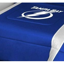 Sports Coverage - Tampa Bay Lightning NHL Bedding - Sidelines Comforter - Full - Show your team spirit with this great looking officially licensed Tampa Bay Lightning comforter which comes in a new design with sidelines. This Tampa Bay Lightning comforter is made from 100% Polyester Jersey Mesh - just like what the players wear. The fill is 100% Polyester batting for warmth and comfort. Featuring authentic Tampa Bay Lightning team colors, each comforter has the authentic Tampa Bay Lightning logo screen printed in the center. Soft but durable. Machine washable in cold water. Tumble dry in low heat. 100% Polyester Microsuede top and 100% Polyester Jersey  bottom, filled with 100% Polyester Batting. Each comforter has the team logo centered on solid background in team colors. 5.5 oz. Bonded polyester batts. Looks and feels like a real jersey!