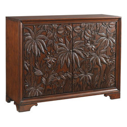 Lexington - Tommy Bahama Home Landara Balboa Carved Door Chest - Inspired by the distinctive spirit of luxurious destination travel, this stunning piece offers refined detailing in it's most sophisticated form. Intricate door carvings, influences by indigenous cultures, evoke a sense of adventure and curiosity as your eyes explore the lush jungle scene filled with delightful details. Behind the magnificently doors are eight adjustable shelves and two drawers for ample storage.
