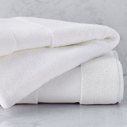 "Frontgate - Resort Cotton Bath Towel - Luxury bath towels are generously oversized in an array of vibrant colors. Long-staple Turkish cotton that is finely combed for a smooth, soft feel. 700 grams per square meter results in superior plushness and absorbency. ""Zero Twist"" process plumps and stabilizes the yarn while revealing more of the cotton fiber. Add a monogram to the elegant, 5"" wide dobby border on bath towels, sheets and hand towels. Softer and longer than towels found at many five-star hotels and spas, our Resort Cotton Towels are lofty, thick, and as luxurious as any in the world. These zero-twist towels are crafted from pure, 100% long-staple Turkish cotton woven to 700 gsm. The end result is luxuriant softness and absorbency that outperforms others..  . . Bath towels feature a 2-1/2""H monogram; hand towels feature a 2""H monogram regardless of font style. View towel care instructions. Made in Turkey . Please note, personalized items are nonreturnable. Allow 3-5 additional days for delivery."