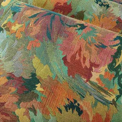Thrive Upholstery Fabric in Marine - Thrive in Marine is a colorful upholstery fabric with an abstract floral pattern. This unique fabric works well for accent pieces or pillows. American made from a blend of 50% cotton, 30% rayon, and 11% polyester. Cleaning code: S. Repeat: 29″ V; Width: 54″.