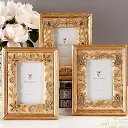 Brocante - Set of 3 -Gold Frames - Bead Embroidery - 4 x 6 - They call to mind the timeless allure of glamorous Parisian boudoirs graced with fine fittings. The Gold Vintage Photo Frames with Beaded Embroidery lend an heirloom quality to your cherished photos or antique paper ephemera. Individually, each frame presents as an intricate artwork; together, they create a dramatic collection within your transitional decor. Available as a set of three designs.