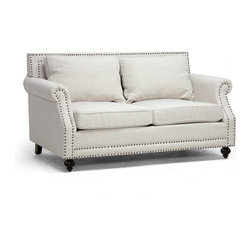 Wholesale Interiors - Mckenna Beige Linen Modern Loveseat - Traditional comforts, modern style. The Mckenna Loveseat has everything you need for optimum comfort: a high backrest, comfortable cushioning, and suitable seat height. A solid birch frame, foam cushioning, and beige linen upholstery set the stage for modern living room style. Bronze upholstery tacks edge the outline of the designer loveseat and black wooden legs with non-marking feet stabilize it. All cushions are removable and repositionable. Minor assembly is required for this Chinese-made designer living room furniture. Please spot clean only. The Mckenna loveseat is also available as a sofa (sold separately).