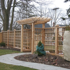 Traditional Landscape by Forest Fence & Deck Co Ltd.