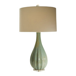 Jadeite Refuge Lamp - The green of a newly flowering English garden infuses the Jadeite Refuge Lamp with a quiet, calming beauty. The simple teardrop shape, enhanced with gentle fluting, rests on a shimmering disc that complements the reflections of light that dance along the lamp's ceramic curves. This tabletop lighting solution will blend harmoniously with the appointments of a boudoir sitting room, a sun room, or a great room.