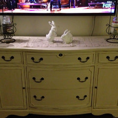 Updated a tired cherry credenza with a vintage cream finish and a waxed top.