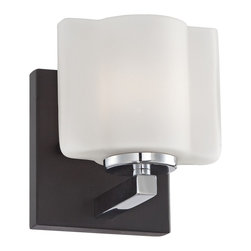 "Lamps Plus - Transitional Cressmont 5 3/4"" High Etched Opal Glass Sconce - Glistening and versatile this sconce works great in many locations. Perfect near a sink or mirror for bright illumination in bathroom areas. A chrome finished arm is paired with a dark brown finish backplate and etched opal glass. Chrome finish arm. Dark brown finish backplate. Etched opal glass. Includes one 60 watt G9 bulb. 5 3/4"" high. 5"" wide. Extends 5 1/2"" from the wall.  Chrome finish arm.  Etched opal glass.   Dark brown finish backplate.  Includes one 60 watt G9 bulb.  5 3/4"" high.  5"" wide.  Extends 5 1/2"" from the wall."