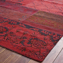 Cadiz Rug, Red - Handcrafted in India, this rug definitely brings a bit of a global feel into a room. The different shades of red and patterns really make it an interesting piece.
