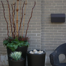 Modern Outdoor Pots And Planters by Rediscover Your Home