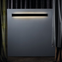 """Marset - Continua Wall Sconce - Conceived as a modular system for producing lengthways strips of light, it is designed to be included in any surroundings using decorative resources. The frontal profile made of transparent polycarbonate makes it possible to slot in an exchangeable film made of translucent materials (such as pleated raw cotton, white linen or tobacco-colored fabric) or opaque black film, which generates indirect light. Warm and understated, it explores new possibilities for interior design. Presented in four different lengths, it can be installed as isolated modules, or continuous strips can be created to illuminate corridors, headboards for beds, etc. Its multi-faceted design also allows it to be used as a base for illuminated signs, and includes an IP44 model which is ideal for bathrooms. Features: -Wall sconce. -Continua collection. -Available in several films. -Available in several sizes. -Extruded anodized aluminum structure. -Polycarbonate diffuser allows exchanging of films of different texture. -Chromed aluminum side over. Specifications: -23.6"""" accommodates: 1 x 24w T5 HO Mini Bipin. -34.6"""" accommodates: 1 x 39w T5 HO Mini Bipin. -47.2"""" accommodates: 1 x 54w T5 HO Mini Bipin. -59"""" accommodates: 1 x 80w T5 HO Mini Bipin. -23.6"""" dimensions: 4.8"""" H x 23.6"""" D. -34.6"""" dimensions: 4.8"""" H x 34.6"""" D. -47.2"""" dimensions: 4.8"""" H x 47.2"""" D. -59"""" dimensions: 4.8"""" H x 59"""" D."""