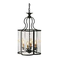 Kathy Kuo Home - Rudolpho Wrought Iron Seeded Glass Clover Leaf Lantern Pendant - Curved multi panel glass sides form a cloverleaf design in this unique silhouette.  Wrought iron frame is finished in an old world iron finish.