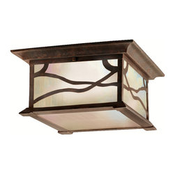 Kichler 2-Light Outdoor Fixture - Distressed Copper Exterior - Two Light Outdoor Fixture. The incomparable trailing design of this flush mount fixture from the Morris collection reflects southwest mission style. Distressed copper finish along with the inside etched, iridescent -seedy glass will be admired time and again. 2-light, 60-w. Max. 12 sq. , Height 6. UL listed for damp location.