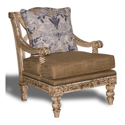 CASTILLA LIVING ROOM CHAIR - Is it a chair or is it a work of art? You make the call. Just be sure to place it where someone will enjoy the comfort of the down fill and its aesthetically pleasing lines