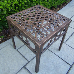 Oakland Living - Oakland Living Mississippi Cast Aluminum End Table - 2106-AB - Shop for Tables from Hayneedle.com! A beautiful combination of Southern elegance and modern design the Oakland Living Mississippi Cast Aluminum End Table features intricate scrollwork and lattice details that complement any outdoor furniture. Crafted from rust-free hand-cast aluminum this end table has a gorgeous hardened powder coat finish in your choice of color. It is also fade- chip- and crack-resistant. Ideal for displaying your favorite plants or as a place to set your book or drink down while outdoors this end table can easily be used as a stand-alone piece or as part of a set. It blends in well with almost any patio furniture and is great as a finishing piece to your outdoor sofa lounge chair or even chaise lounge. A beautiful and durable piece this end table is designed to last for years.