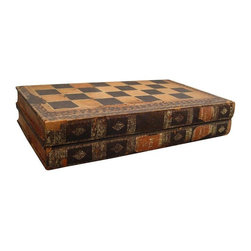 "Pre-owned Backgammon Chess Board Book Box - Antique backgammon and chess board made to look like a large two volume book set. Hinged wooden box in book shapes covered in thin leather, tooled and dyed. Volumes one and two ""English Games"". Black and ochre with gilt tooling, decorative end papers and made in the late 1800's . It has a VERY well worn look, losses of leather and paper, tears and loose bits. The wood box and hinges are still quite sturdy. Interior backgammon game board has much loss of leather. However, if you are looking for an unusual piece with loads of character and a great look, this is it. Be aware that after shipping it will probably have a few more bits of leather or paper come loose."