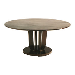 Baker Furniture - Round Dining Table - Inspired by LeLeu, a French designer in the 1930s, this rich mahogany table was designed for both function and unadorned beauty. A single center pedestal and the absence of a gallery complete the piece's pure, simple style.