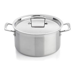 "Le Creuset® Stainless Steel 6.4 qt. Stock Pot with Lid - Now experience the heritage and quality of Le Creuset in hi-tech, tri-ply cookware that conducts heat so evenly and energy-efficiently that only low to medium heat is needed for most cooking. Premium quality stainless steel sandwiches a ""total"" aluminum core—from the base all the way up to the drip-free, precision pour rims—for even heat throughout. A special magnetic steel makes it perfect for all cooktops, including induction. Ergonomic assist handle provides a comfortable, confident grip; tight-fitting lid locks in flavor and moisture. This size stock pot is ideal for boiling vegetables or pasta, corn and lobsters, simmering soup, or creating a flavorful stock."