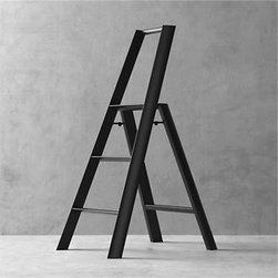 "Hasegawa® Lucano Black 3-Step Stool - The beauty is in the details when it comes to this meticulously designed 3-step ladder. Expertly crafted and assembled by hand, and finished with a satin black powdercoated finish, smooth aluminum and steel form triangular tubes that meet in a slim, graceful profile. From the secure safety latch and non-skid feet to safety-minded steps with integrated grooves for tread, each and every element is thoughtfully considered—even the fastening screws are hidden. Sturdy yet surprisingly lightweight, this ladder weighs only 11 lbs. for easy portability and supports up to 300 lbs. in weight. Engineered to fold to a streamlined 7"" deep, it can also stand on its own without having to lean against the wall. Created by the experimental design lab Metaphys and Hasegawa Kogyo Co., the top manufacturer of ladders and scaffolding in Japan since 1956, this exceptional ladder has received many design accolades, including the RedDot Design, Good Design and JIDA Design Museum selection awards."