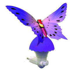 Creative Motion - Fiber Optic Color Changing Butterfly Light, Purple - Elegant detailed butterfly replica accents a compact night light. Pink fibers. Night light with a light switch. You can turn it on and you can use this as a night light.