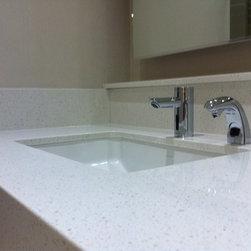 "Various Quartz Countertops - LG Viatera Quartz bath vanity in ""Crystal White"" with a custom mitered edge detail and undermount sink"