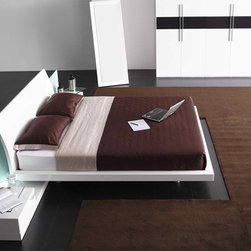 Italian Quality High End Modern Furniture - Contemporary bedroom with illuminated frosted glass headboard. None speaks better of sophistication than the Nora Contemporary Bed with its affluent, high quality materials and refined lines.