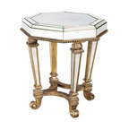 Ambella Home - Voranado Octagonal Accent Table - This accent table has designs on the Hall of Mirrors in Versailles. The antique mirror accents, curved feet and striking detailing will remind you it's not all smoke and mirrors.