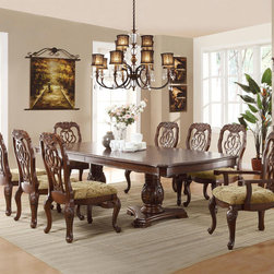 Marisol Traditional Dining Set - Create a dining room that will impress your dinner guests for years to come. Each piece of this collection demonstrates delicate craftsmanship and intricate carved detail. The table features a double pedestal base, The collection is crafted from popular solids, cherry and burl veneers.