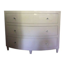 World's Away Natalie Dresser in White Lacquer - This bow front dresser has a pretty and clean look, making it a versatile addition to your bedroom. Features include a white lacquer finish, an inset beveled mirror top, three drawers with glides, and clear round glass knobs with nickel detailing.