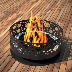 Steel Bubble Outdoor Fireplace - Summer calls for late-night chats over the glow of a flickering fire. No ordinary outdoor fireplace, this one stands strong on a pedestal mount and has a design of cutout circles. No matter the season, gather chairs and your favorite people around the fire for great conversations and dazzling warmth.