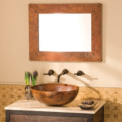 Tuscany Small Rectangle Copper Mirror by Native Trails - Bold focus and old world charm; that's what Tuscany Rectangle is made of. Its wide, Tempered finish frame accentuates hand-hammered copper's unique patina, while its beveled glass and hand-forged nails provide a punch of decorative display. Available in small or large; mounts vertically or horizontally. See website for pricing.