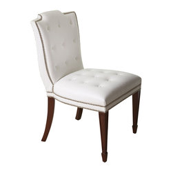 Atlanta Chair - White - Pure white, tufted leather looks classic, upscale, and slightly indulgent on an upholstered side chair design which suggests the gracious living and lush luxury embodied in the manorial breakfast room. Paired with sheer lace curtains, the Atlanta Chair looks romantic yet defined yet the combination of saber legs and spade feet also beautifully suits a room with a more eclectic outlook on the past.