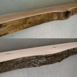 """Log Style Mantel - Enhance the """"country"""" or """"rustic"""" look of your fireplace with a Log Style Mantel. Most fireplace mantels are made from thin pieces of wood assembled to look like a solid beam. Now, a true solid wood mantel is available. These mantels are sawed to emphasize the irregular shapes and natural character of wood."""