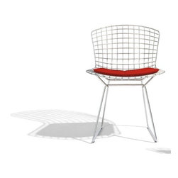 """Knoll - Bertoia Side Chair - THE DESIGN   FEATURES AT A GLANCE   DIMENSIONS   ORDER WITH CONFIDENCE The Design Harry Bertoia's 1950 experiment with bending metal rods into practical art produced a revered collection of seating, including this side chair. Innovative, comfortable, and strikingly handsome, the Bertoia Side Chair's delicate filigree appearance belies its strength and durability. In Bertoia's own words, """"If you look at these chairs, they are mainly made of air, like sculpture. Space passes through them."""" The Bertoia Side Chair's frame is available in Polished or Satin Chrome or six durable outdoor powder coat colors. The optional seat pad provides added comfort and is offered in a wide variety of quality fabrics and leathers. Back to Top Features at a Glance: *This product is made to order and thus customer orders cannot be canceled once the products go into production Design Year: 1952  . -Welded steel with rods of polished or satin chrome or highly durable outdoor powder coat in six colors. -Frame is scratch, stain, and chip resistant. -Stainless steel connections. -Plastic glides included. -The Knoll logo is stamped into the base of the chair. -Optional seat pad is available in hundreds of fabric and leather choices. -Cushion secured to chair with lock-snaps. -Side chair with black, white, red, green, yellow or blue frame finish and vinyl upholstery suitable for outdoor use Awards: -""""Designer of the Year,"""" 1955, USA. -Certificate of Merit, American Institute of Architects . Care & Maintenance: -For information on caring for your Knoll furniture please view the Knoll Care & Maintenance Guide Back to Top Dimensions: . -Overall Dimensions: 28.75"""" H x 21.75"""" W x 19.75"""" D. -Seat Height: 17.75"""" . Order with Confidence: -Sustainability Statement: Sustainable design is a key component of Knoll's environmental focus. Knoll's commitment to social responsibility and a healthy environment has prompted the company to further articulate its longstanding environment"""