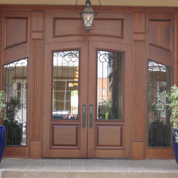 St. John Square Office Building - This massive entry, DbyD-6010,  was custom designed and built of Mahogany for the St. John Square Office Building in the Old St. John Square Historical District in Covington, Louisaina.  .  This Entry was stained and finished by Doors By Decora using English Chestnut Stain.  The doors and sidelites have clear tempered insulated glass and custom designed wrought iron grills.  The hardware is Baldwin Edinburgh 6952-112.