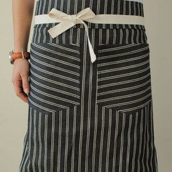 Dearborn Ave. Apron - These custom unisex aprons were made by a chef for chefs. They fuse style with design elements needed in the kitchen. I love the fabrics.