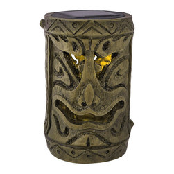 Friki Tiki Smiling Tiki Solar Powered Torch - This awesome tiki solar garden light is perfect for lighting pathways or fences, and makes a lovely garden accent. Included with the lamp is a post mounting bracket, a ground stake, 2 extension poles, and a pole connector so you can display them any way you choose. It is made of cast resin, measures approximately 6 inches tall, 3 3/4 inches in diameter, and looks as though it has been carved from bamboo. The light is a yellow LED that flickers like a candle, turns on automatically in dark conditions, and lasts up to 10 hours with a full charge. This tiki is an essential addition to any tiki bar, is a wonderful decoration for island themed parties, and is sure to be admired.