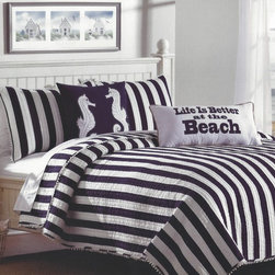 Navy & White Cabana Striped Bedding Set - This cabana striped quilt set is fresh, crisp and perfect for nautical or seaside style.  Wide navy and white stripes have a casual chic and contemporary beach look which will set the stage for any coastal decor.  White pom-pom fringe around the quilt and shams adds nautical charm and a decorator's touch.  The coordinating accent pillow is made of bright white, 100% cotton and decorated with a navy blue starfish and silver accent beading.