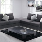 Modern Gray Sectional Sofa - This Modern Gray Sectional Sofa is upholstered in a durable dark gray fabric. The pieces can be arranged in a variety of ways. Manufactured by American Eagle Furniture.